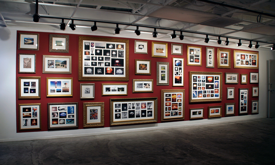 "<br/>Family Photos, 2007<br/>88"" x 300"" (variable size)<br/>laser jet on paper with lettering and frames"
